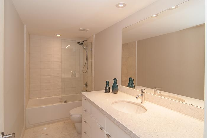 Guest bathroom renovation miami for Can you use kitchen cabinets in bathrooms